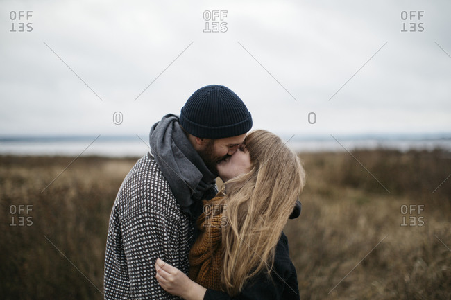Happy couple kissing each other
