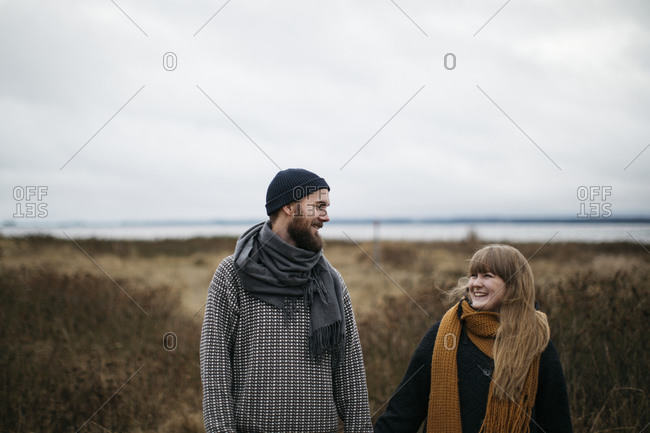 Couple standing together walking outdoors