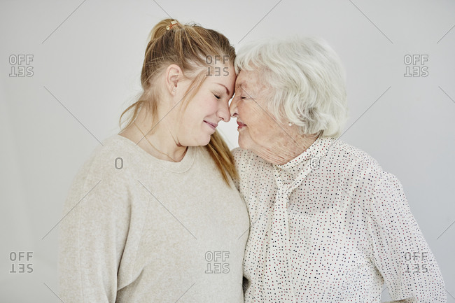 Grandmother with granddaughter, studio shot