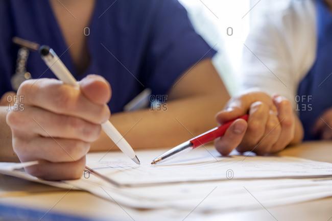 Nurses hands checking medical record