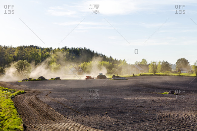 Vehicles on a plowed field