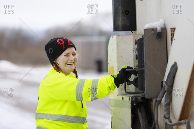 Woman operating a garbage truck