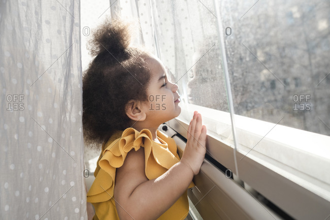 Girl looking through the window