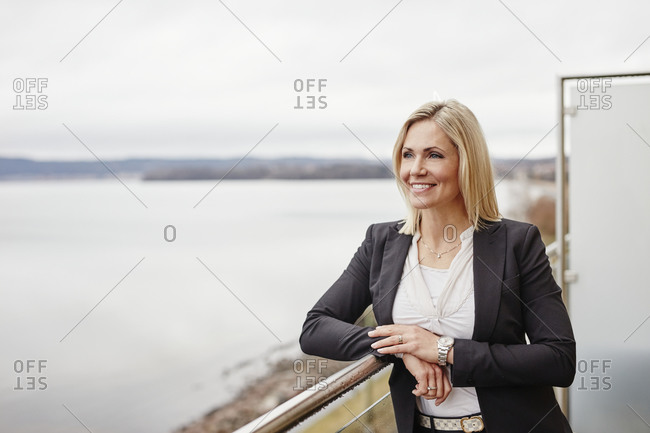 Woman on balcony looking at view