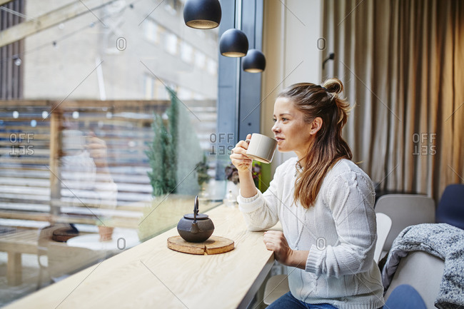 Woman in cafe having coffee