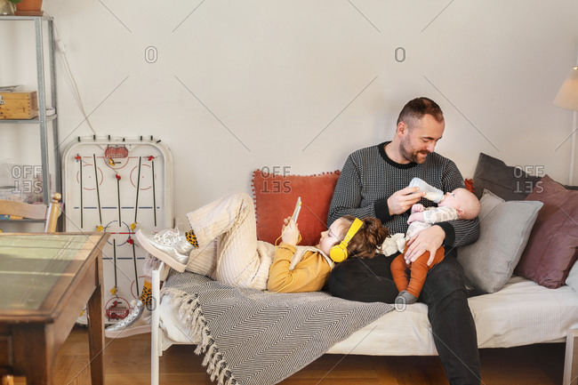 Father with children in living room