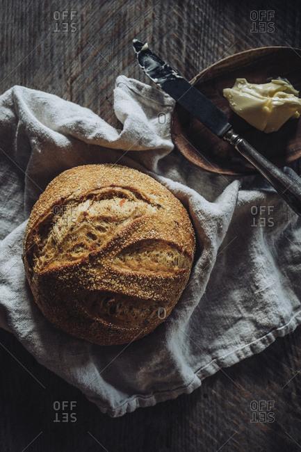 Loaf of bread on kitchen towel