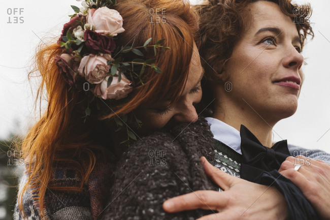 Lesbian couple embracing affectionately, close up