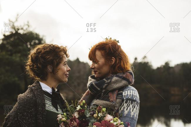 Lesbian couple with a bouquet