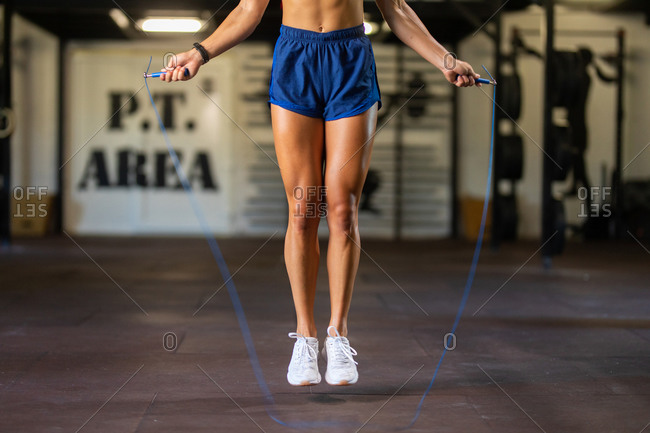 Young woman exercising with a skipping rope in the gym