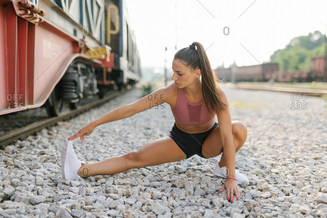 Young woman stretching outdoors before a workout