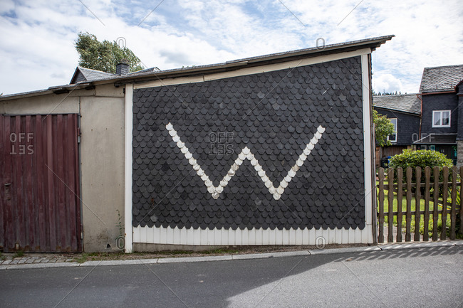 "Saxony, Germany - September 3, 2020: Side of a building with a large ""W"" on the side"