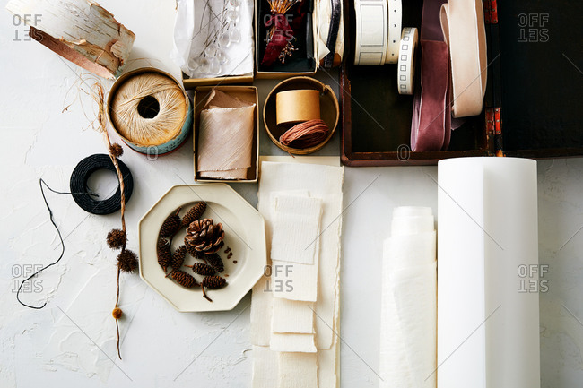 Close up of natural crafting items in boxes on white surface