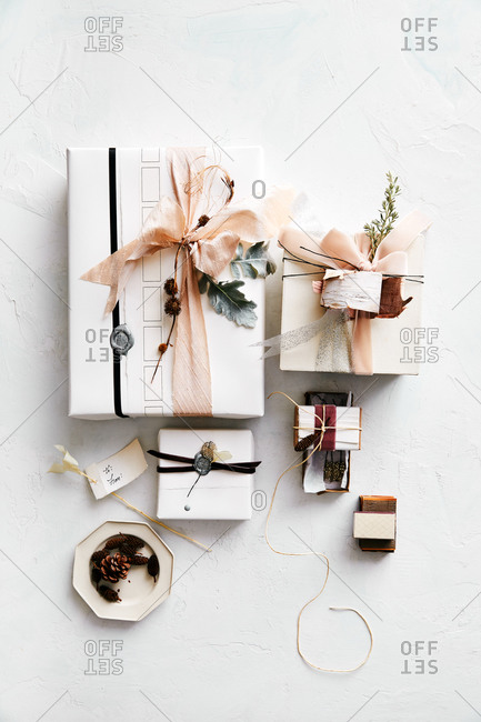 Beautifully wrapped gifts on white surface