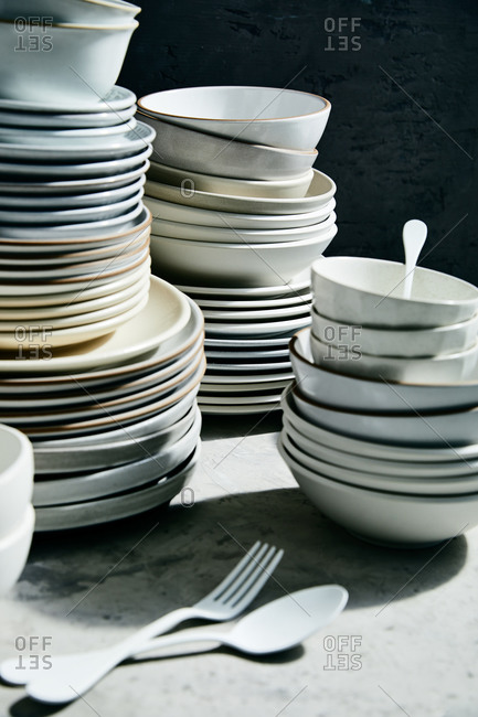 Dishes stacked on marble surface with black background
