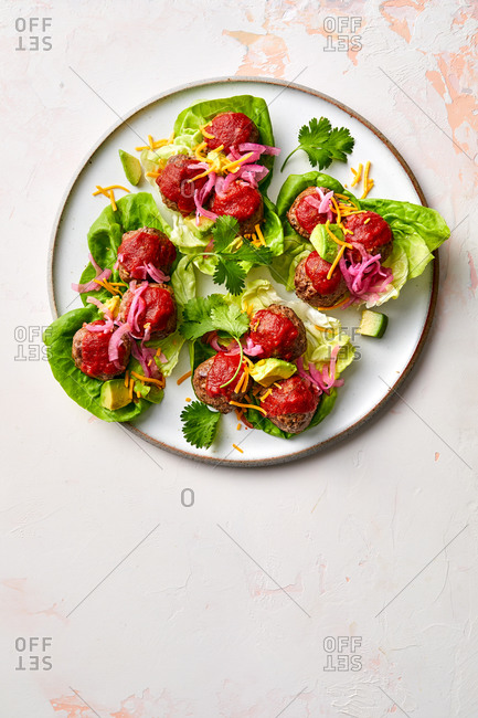 Meatballs and cabbage appetizer on light background