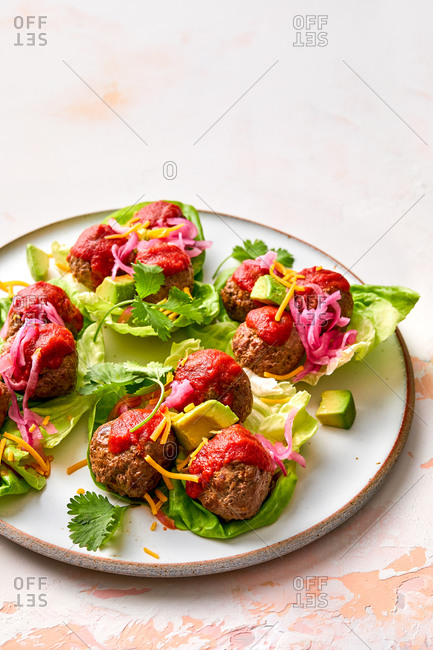 Close up of meatballs and cabbage appetizer on light background