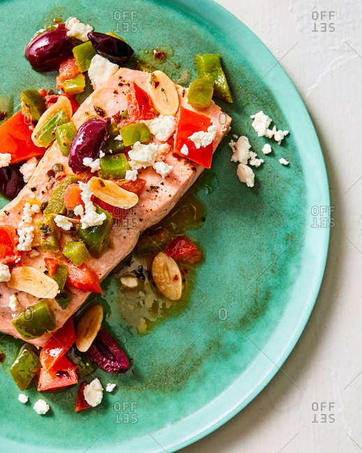 Salmon dish topped with colorful veggies