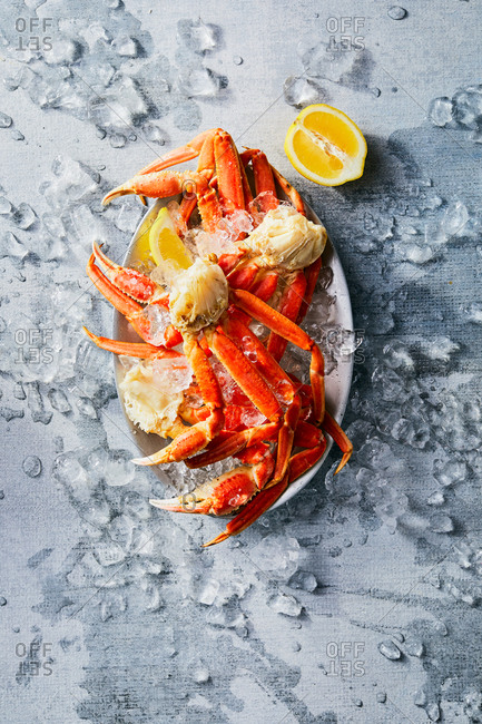 Crab legs on a platter surrounded by ice