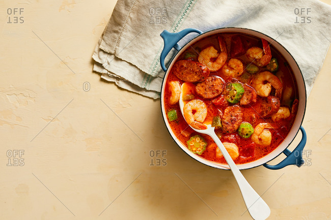 Overhead view of seafood soup in a Dutch oven