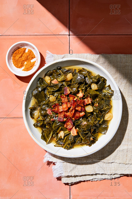 Overhead view of a collard greens dish with bacon