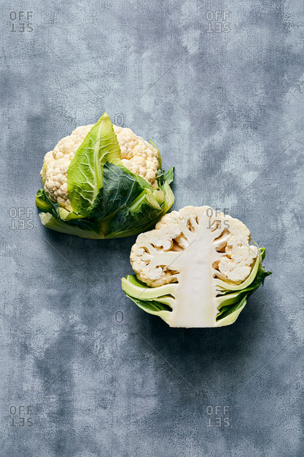 Halved cauliflower on gray surface