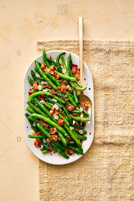 Green bean and bacon dish on burlap