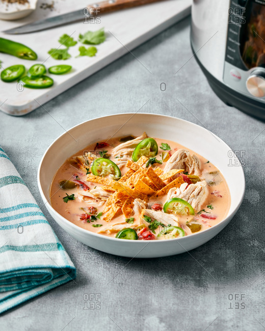 Bowl of spicy chicken tortilla soup