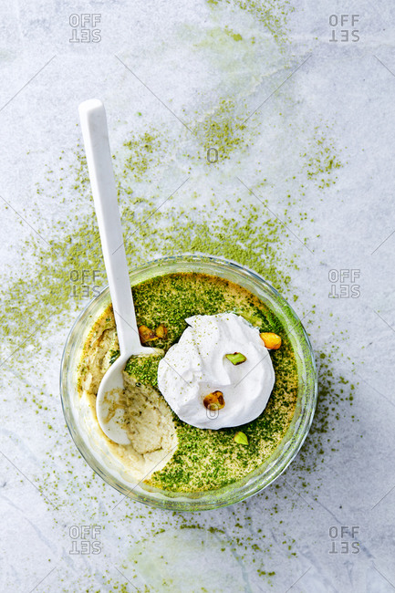 Green tea coconut milk custard topped with whipped cream and pistachios