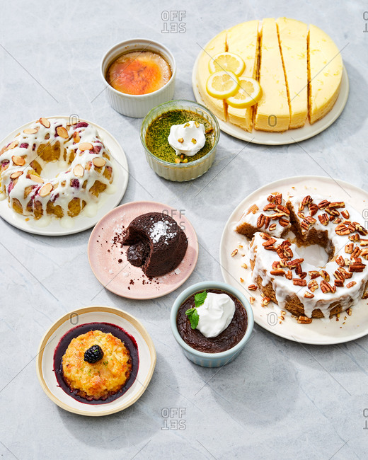 Various desserts served on gray background