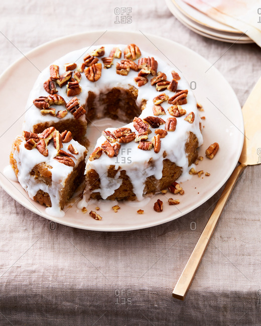 Lemon Bundt cake with icing and pecans