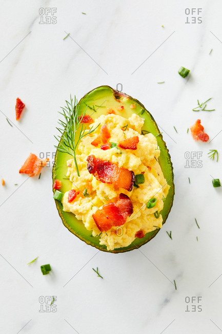 Close up of an avocado stuffed with egg and bacon