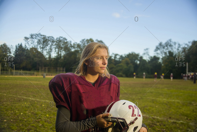 Teenage female football player on field