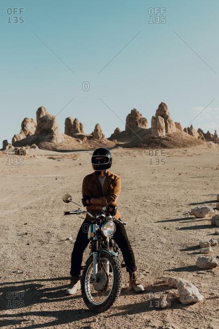 Motorcyclist on stationary bike, Trona Pinnacles, California, US