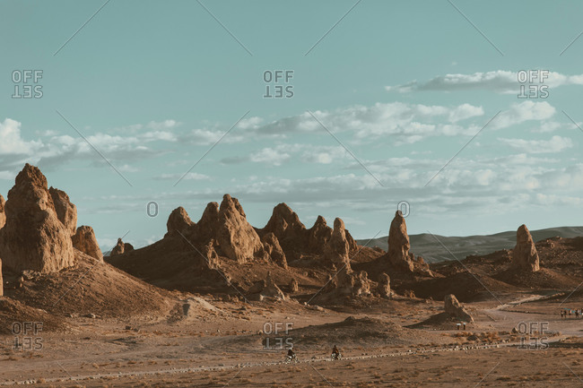 Motorcyclists riding in desert, Trona Pinnacles, California, US