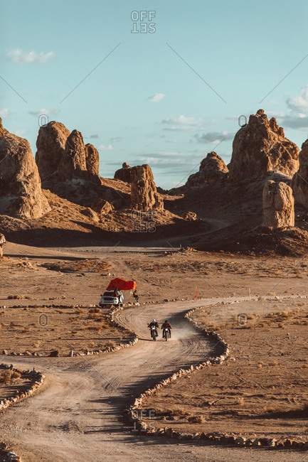 Motorcyclist friends riding in desert, Trona Pinnacles, California, US