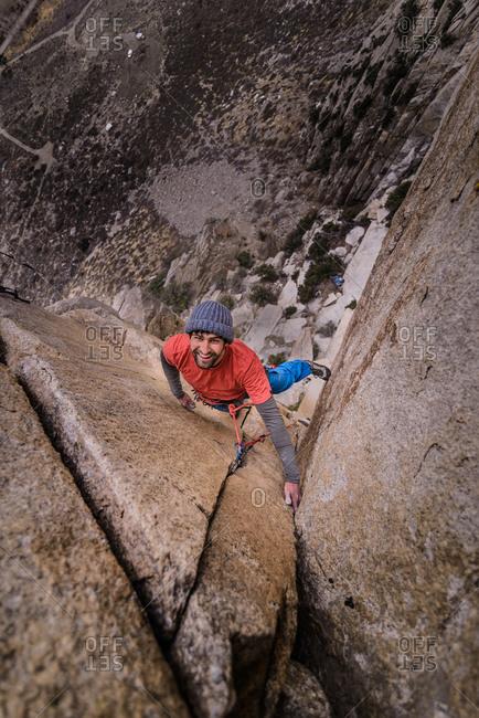 Climber trad climbing, Pine Creek, Bishop, California, USA