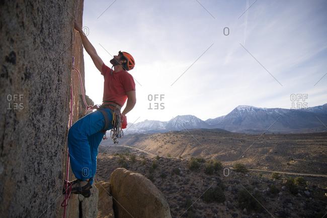 Climber trad climbing, Little Egypt, Bishop, California, USA
