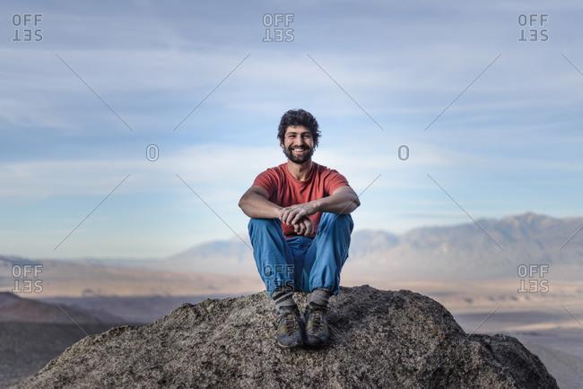 Climber enjoying view on mountain peak, Sierra Nevada, Bishop, California, USA