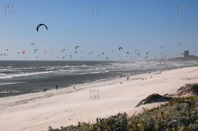 Large group of kite surfers mid air over sea, Cape Town, Western Cape, South Africa