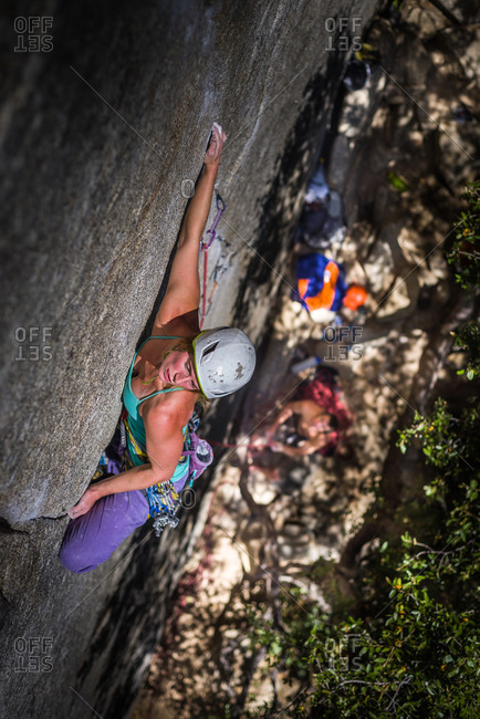 Climber rock climbing, Cookie Cliff, Yosemite National Park, California, United States