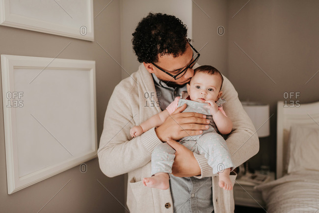 Father with baby daughter with joy