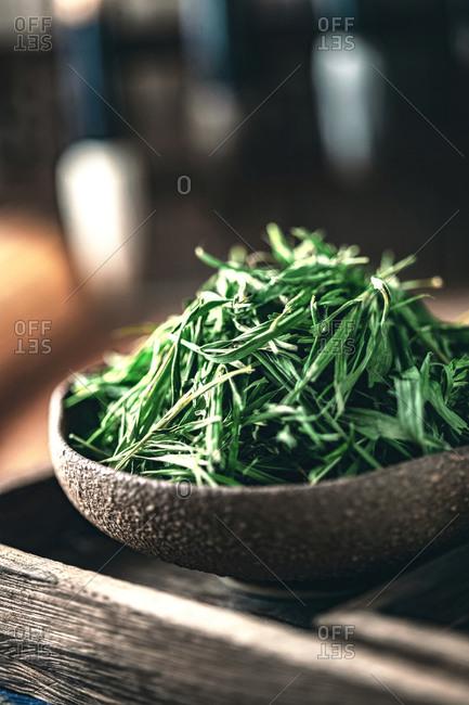 Green tea leaves on tea tray
