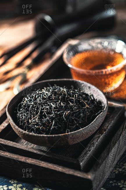 Black tea leaves on tea tray