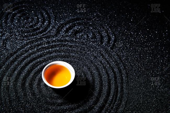 A cup of black tea on a dark table