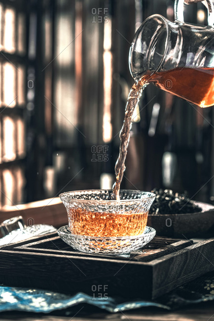 Pouring a glass of green tea