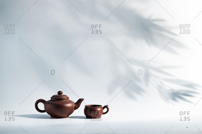 Tea pots with bamboo shadows in the background