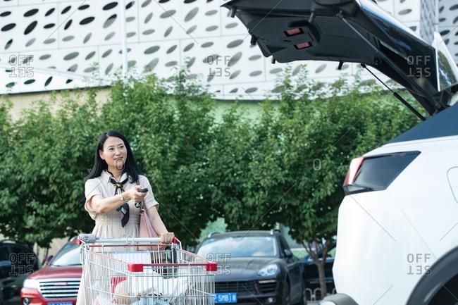 Middle-aged couple pushing shopping cart