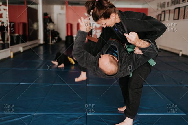 Couple practicing martial arts in studio
