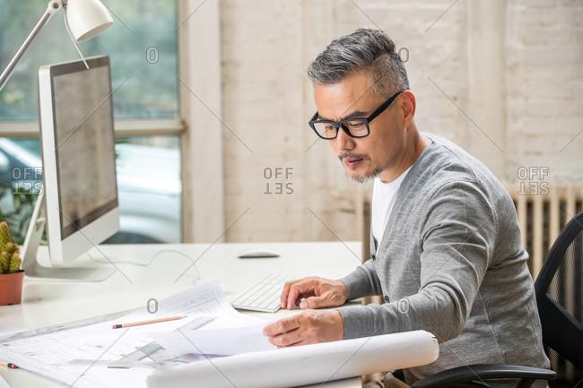 Senior designer working in his office